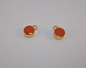 1 set of 2 gold and coral charms