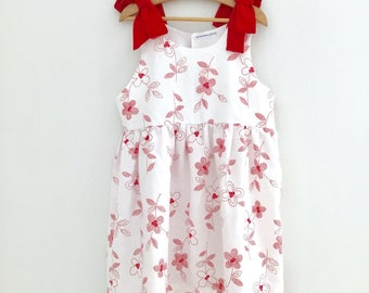 Printed linen dress, red and white, elegant flowers for any occasion.