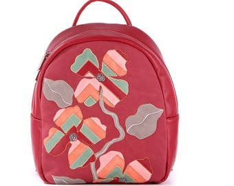 Red backpack with flower