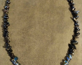 Blue sodalite pedant on labradorite, black obsidian, and titanium coated quartz necklace