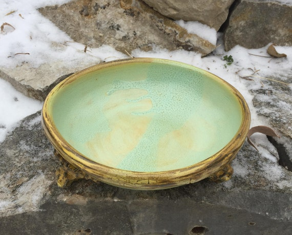 medium ceramic bowl in pale green, beige, and golden yellow