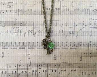 Antique Bronze Trumpet Charm Necklace with green Swarovski accent