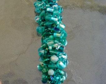 Handmade teal green beaded, crocheted bracelet
