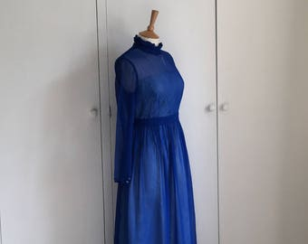 Vintage 1960s cobalt blue chiffon maxi gown with long sleeves and high neck