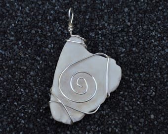 Wire-wrapped white shell pendant
