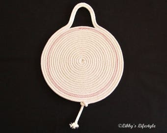 Handmade Rope trivet or pot holder. Pink trim.