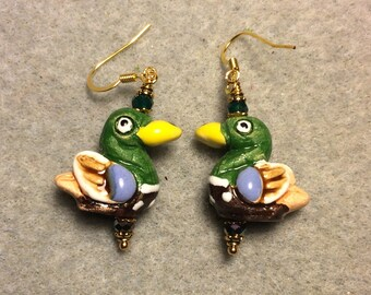 Green, yellow and blue ceramic duck bead earrings adorned with dark green Chinese crystal beads.