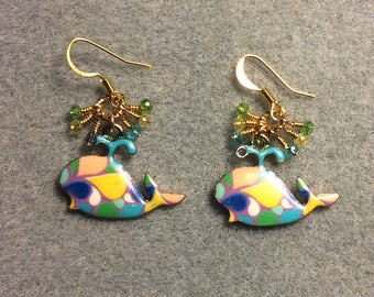 Colorful enamel whale charm earrings adorned with tiny dangling turquoise, yellow, and green Chinese crystal beads.