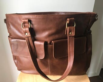 Large,soft and functional handbag purse. Compartments,flat handles and long straps makes a great leather shoulder tote bag. large handbag.
