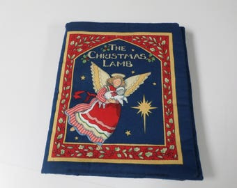 The Christmas Lamb soft baby book  to read and it is vintage
