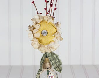 Prim Sunflower with Red Pip Berries' in Vintage glass with Rose hips