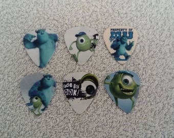 Lot 6 Monster guitar pick and company
