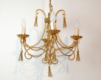 Italian vintage rope and tassel gilt chandelier, 4 arm in good vintage condition. Nice patina. Very decorative piece.