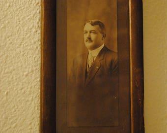 Framed portrait of gentleman in a suit