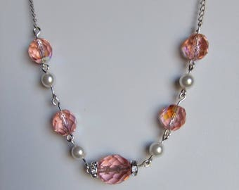 Ringer peach colored Czech beads