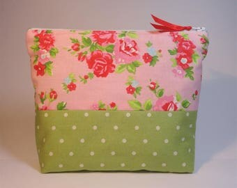 Green cotton with white polka dots and cotton pouch with red flowers roses