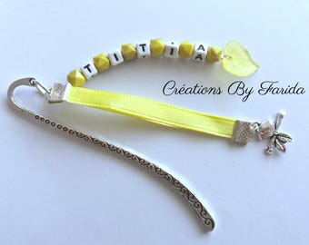 Made of beads silver metal, leaf and yellow ribbon bookmark