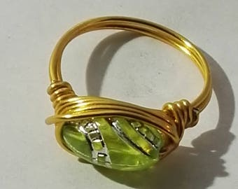 Golden ring with oval yellow ornament