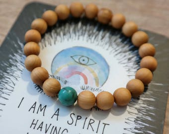 Genuine turquoise surrounded by raw Cedarwood essential oil diffusing bracelet