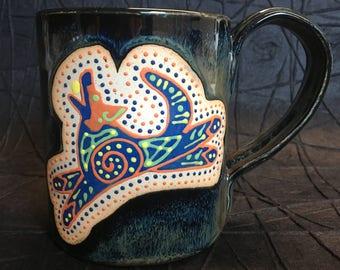 Orange and blue dog mug