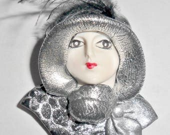 Beautiful vintage white lady woman face resin figural brooch with silver and black hat and scarf with feather