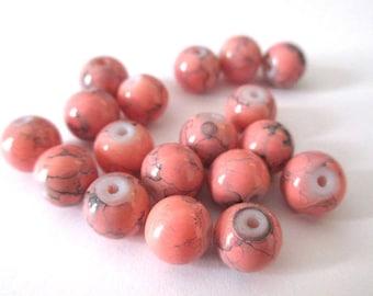10 salmon speckled black glass beads 8mm (B-20)