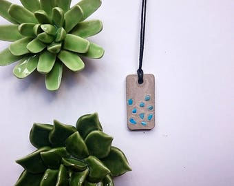 Concrete necklace with turquoise gemstone turquoise