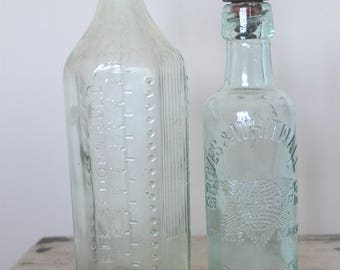 2 Large Vintage Glass Bottles / Vases