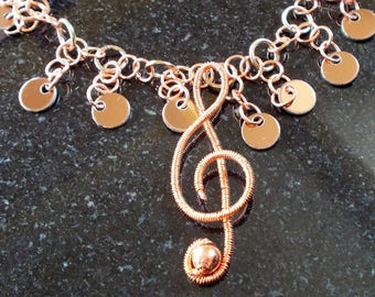 wire-wrapped treble clef pendant