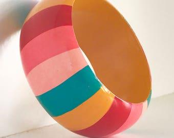 Bright, multicolored wooden bangle bracelet.