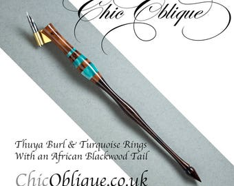 Oblique pen holder, Thuya Burl body with three Pearlised Turquoise rings and an African Blackwood tail
