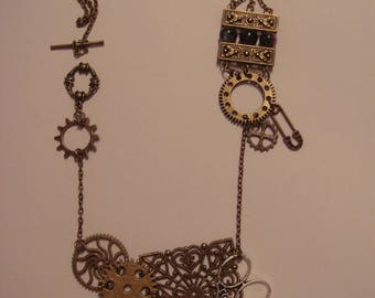 Steampunk necklace with gears, beads, and scissors.