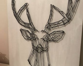 Wood table with Swedish style stag / string art