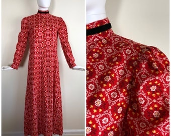 Vintage Womens 1970s Red With White Yellow and Gold Floral Medallion Print Long Sleeve Maxi Dress With Velvet Trim | Size S/M
