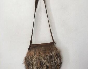 Hand made fur & leather shoulder bag , new designer bag made in USA , recycling leather bag .