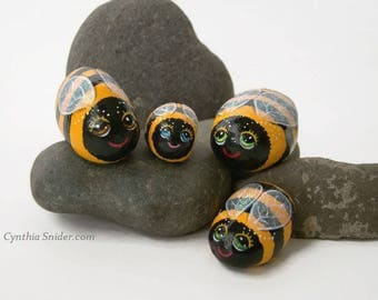 Painted rocks,Painted stones,yellow bee's,bug rocks,cute bee's,fun rocks,garden decor,bumble bee's,yellow stripes,sparkly wings,baby bee's