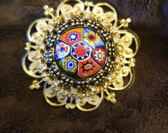 Unique gold plated rhinestone brooch
