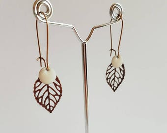 Pair of bronze leaves and white earrings