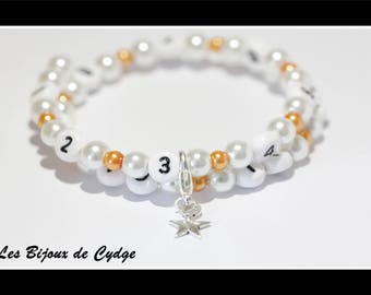 Nursing bracelet on memory wire form of 55mm with glass beads white and orange