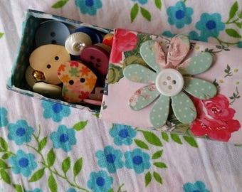 Matchbox full of buttons