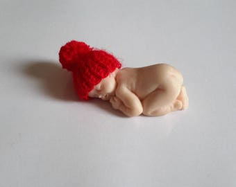 Miniature red baby bonnet in handmade fimo knit tassel