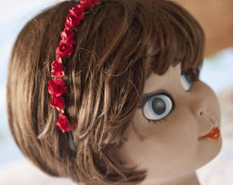 Headband adorned with pretty red roses