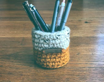 Sweater style pen cup