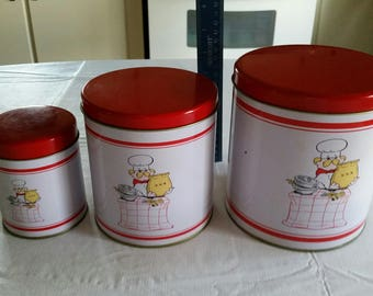antique kitchen canister set 1950 's - baker chef cook pictures - storage metal tins cooking baking red white pizza pie cake stacking art