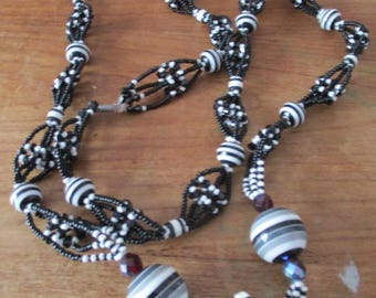 Black and white necklace with stripe pearls.