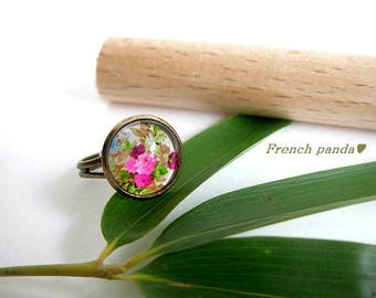 Adjustable ring, floral glass cabochon.