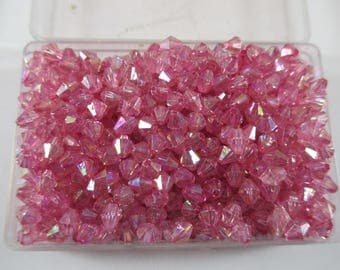 Bicone beads, pink iridescent color.