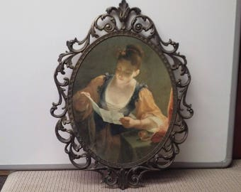 Oval picture with brass frame made in early to mid-1900s