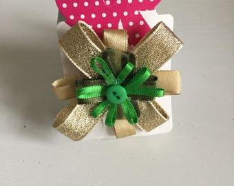 Green and gold circular hair bow
