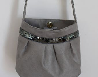 Small purse from gray suede and sequined band khaki